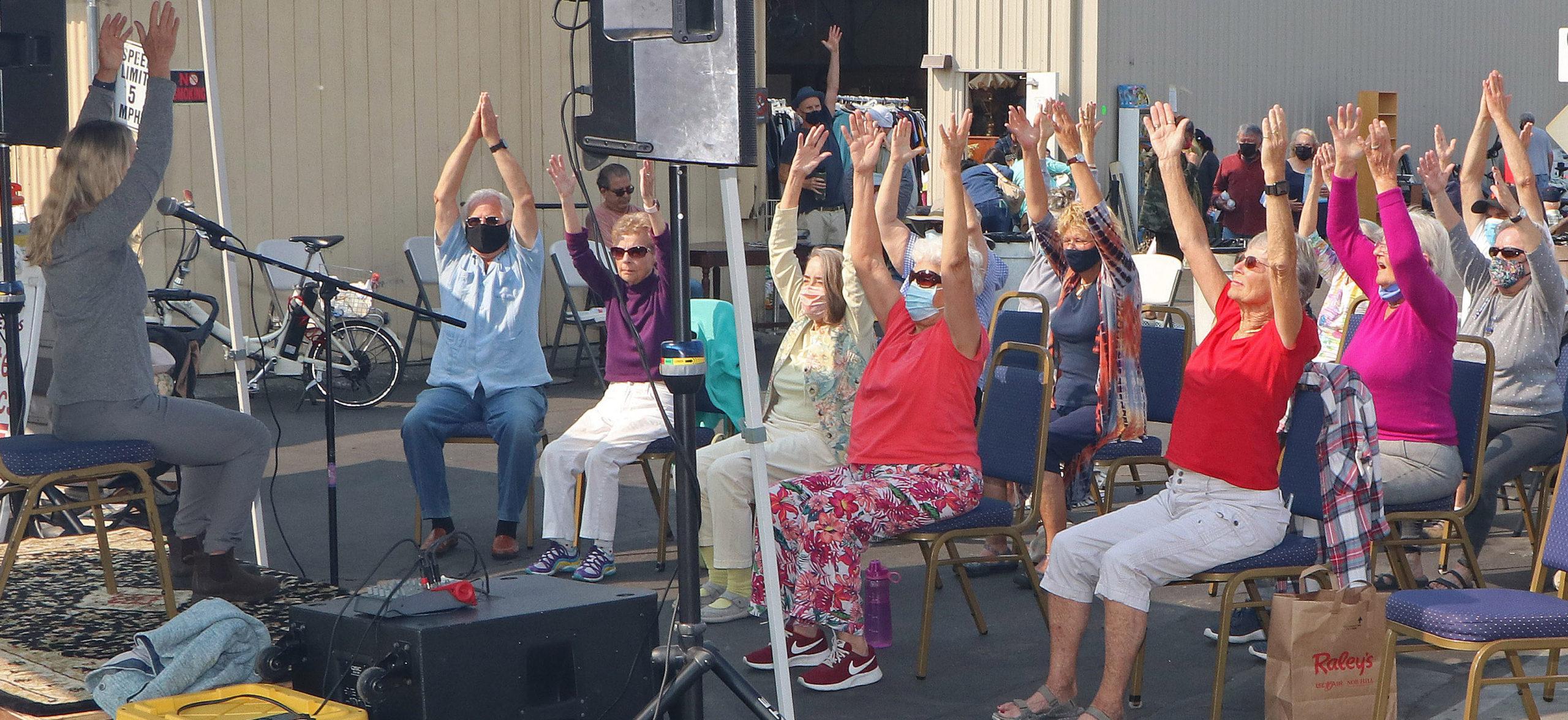 Outdoor chair yoga class at Grey Bears harvest festival